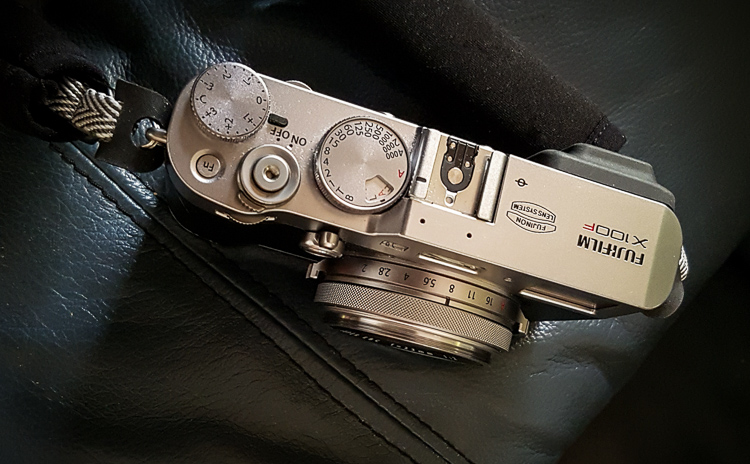close up of the top of a Fujifilm camera buttons and settigs for camera modes.  Refer to your manual as each model can be different