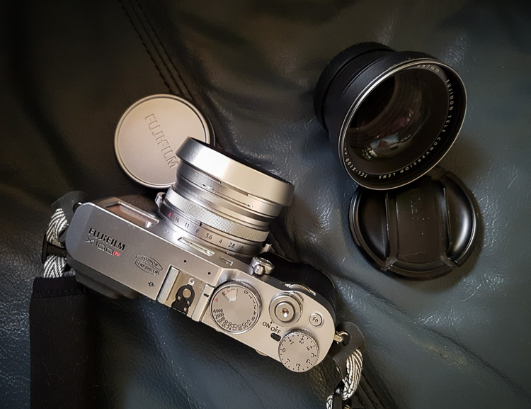 fuji x100f review product shot showing camera, lens and lens cap from above