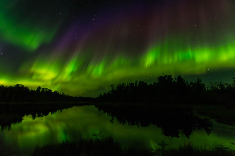 The northern lights and Canadian landscape