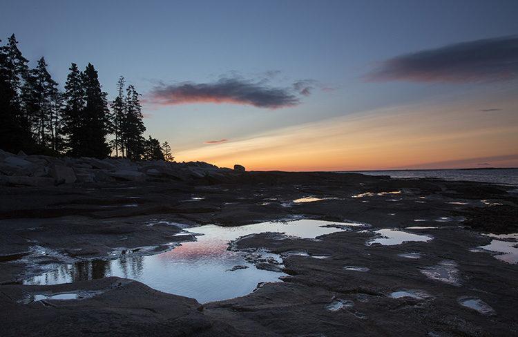 sunrise reflecting across the lake