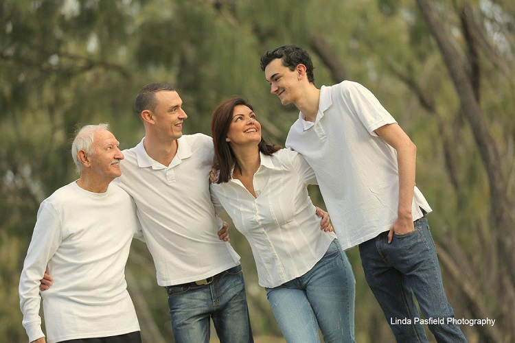 Happy Family Poses For Their Portrait Outdoors