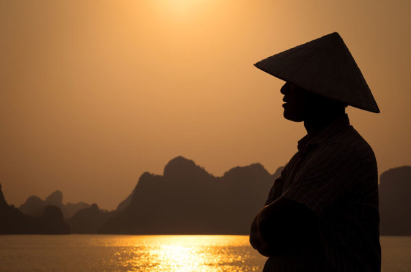 Profile of Vietnamese man in Halong Bay