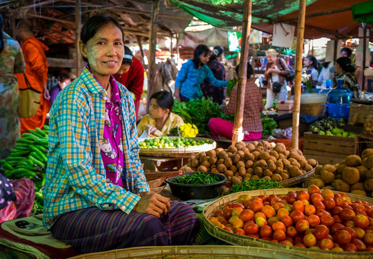 BAGAN, MYANMAR - Woman selling vegetables in the Nyaung U market close to Bagan in Myanmar.