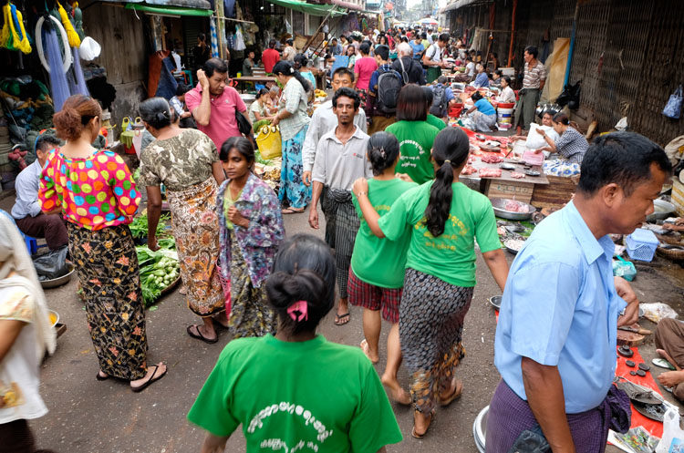 People walking and wandering around the street market of Yangon.