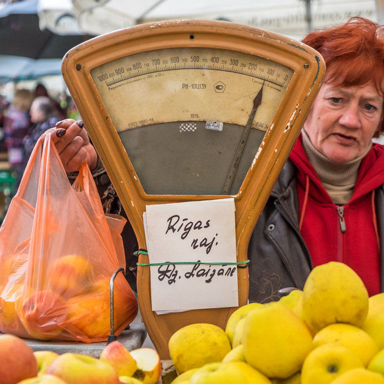 RIGA, LATVIA - CIRCA MAY 2014: Merchant selling apples in the Riga Central Market