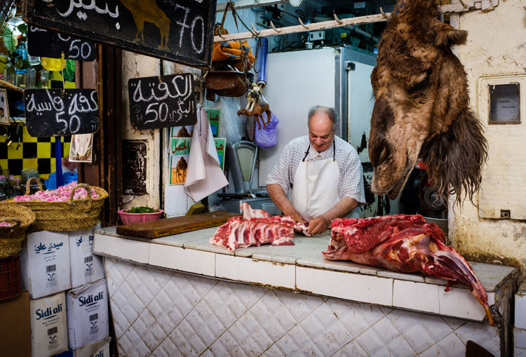 FEZ, MOROCCO - CIRCA APRIL 2017: Portrait of Moroccan meat seller at the Medina in Fez