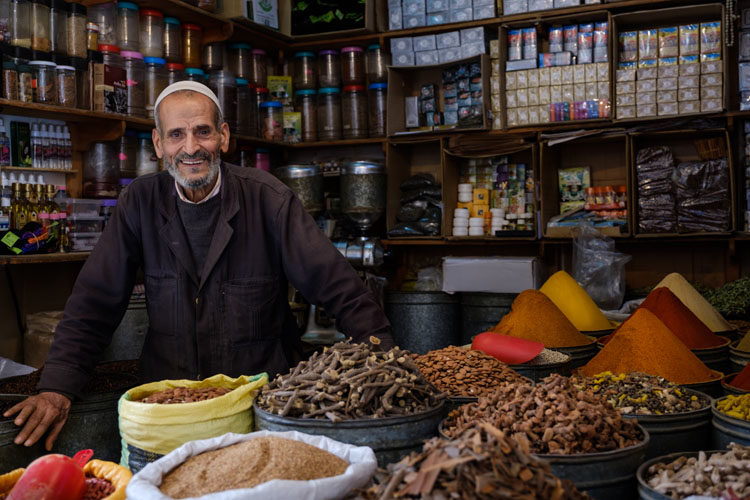 FEZ, MOROCCO -Portrait of Moroccan merchant at the Medina in Fez