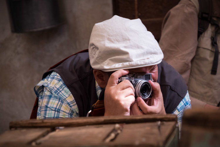 author using his small fuji camera while shooting a local market in Morocco