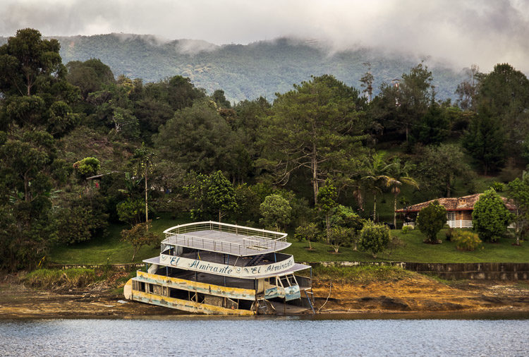 El Almirante ferry wreckage on the side of the lake in Guatapé Colombia