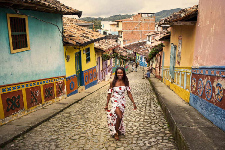 a walking tour guest poses on a street in Guatapé