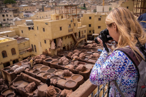 photographer taking photo of the tanneries in Fes Morocco