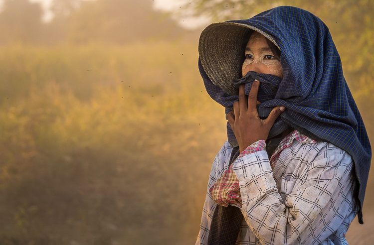 a Burmese farmer in the afternoon sun near her village of Bagan Myanmar