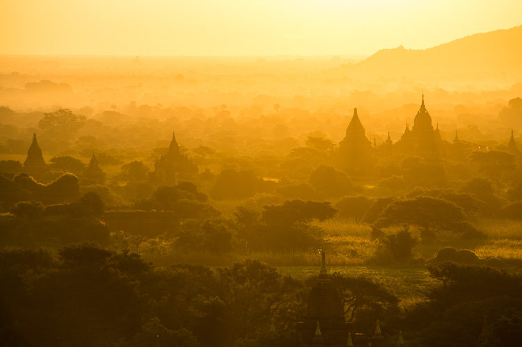 Sunrise over the famous temples and pagodas showing the golden light of Myanmar