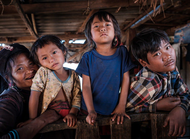 Portrait of an Enn tribe family at the Pan Ian Village