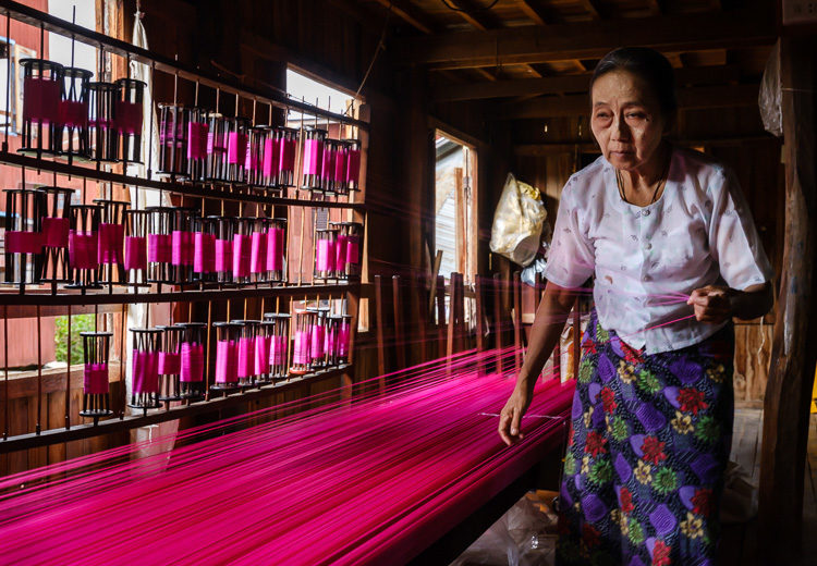 Burmese woman working textiles at Inle Lake Myanmar
