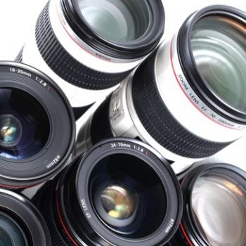 photography equipment display showing some camera lenses