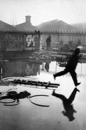Famous photographer Cartier-Bresson's famous photo Man Jumping the Puddle taken 1930
