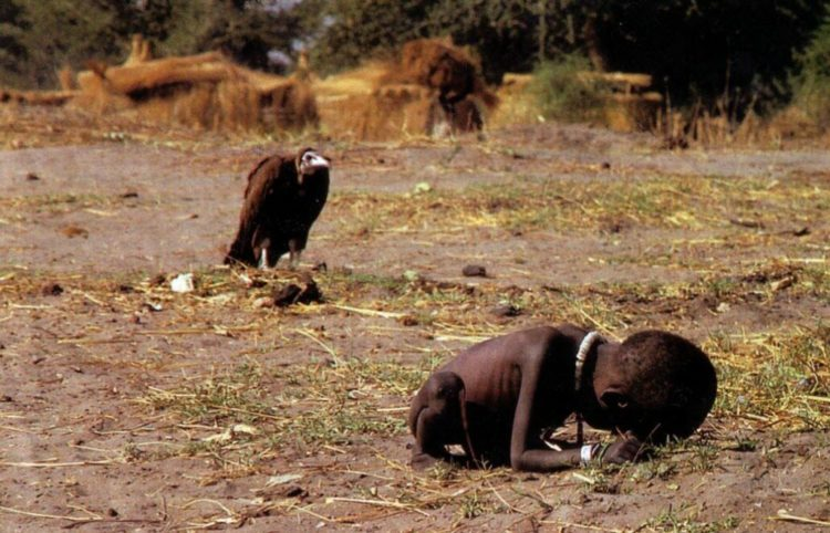 famous photo by Kevin Carter showing a small African child starving while a vulture waits behind