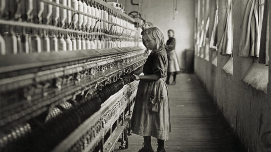 A famous photo of a child in a Carolina cotton mill by Lewis Hine in 1908