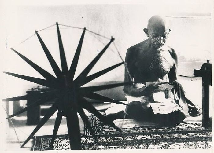 famous photographer Margaret Bourke-White's iconic photo of Ghandi spinning wool taken in 1946
