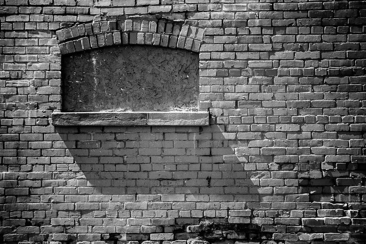 shadows on a brick wall - photography challenge