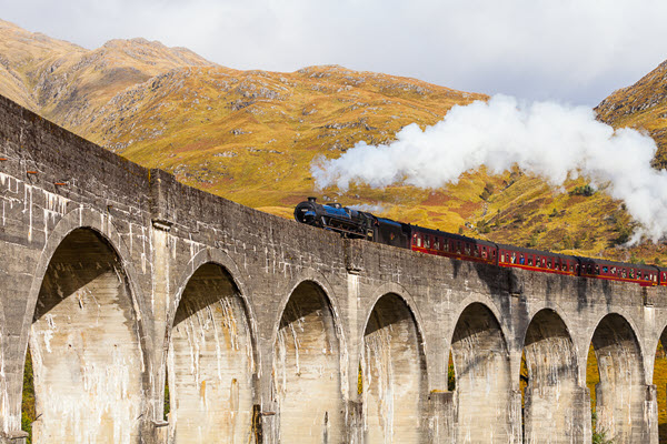 Jacobite steam stream going across Glenfinnan viaduct, Glenfinnan, Scotland