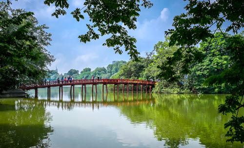 view of the huc bridge over the hoan kiem lake in hanoi vietnam