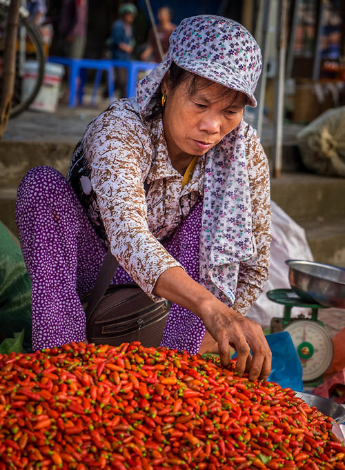 vietnamese woman with peppers in bac ha market vietnam