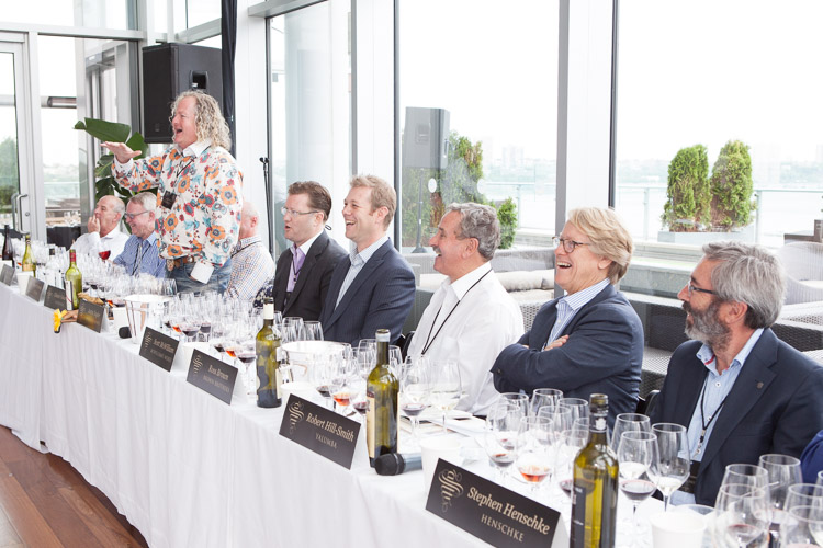 photographer captures the expressions on the faces of the judges at the wine tasting event