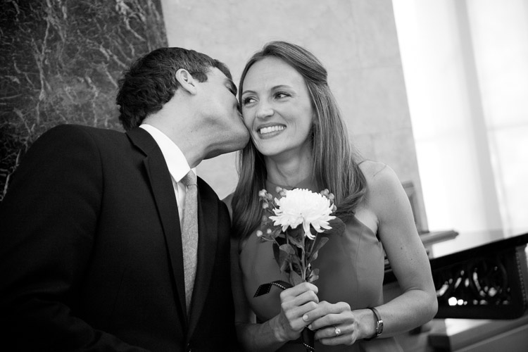 photographer captures the moment when the man kisses the woman