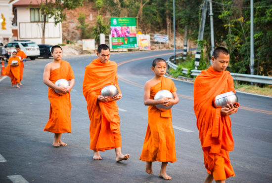Thai buddhist monks walking