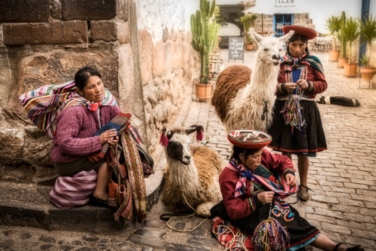 llamas and ladies on the streets of Cusco Peru