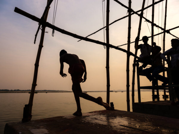 boys jumping into the river in Varanasi