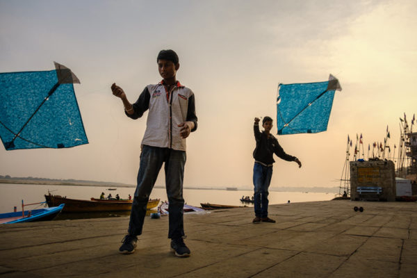 Indian boys playing with kites