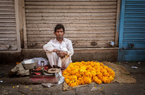 street vendor sells flowers in Delhi