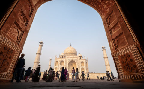 the taj mahal in Agra India through a gate