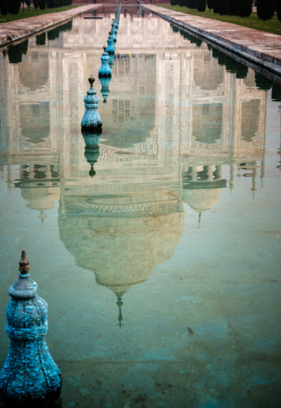 Agra India - the Taj Mahal is reflected in a pool