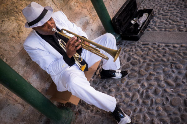 Trumpet player plays for tourists in Old Havana Cuba