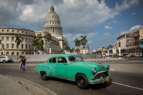 Classic car in front of the Capitol building in Old Havana Cuba