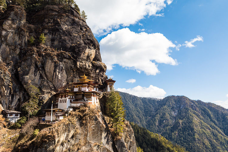 the Tigers Nest monastery in Bhutan seems to cling to the side of the mountain