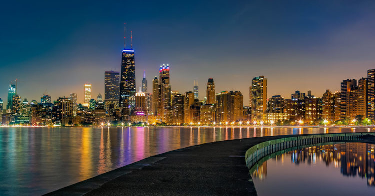a night photo of Chicago, Illinois skyline from the lake with camera settings of Shutter Speed: 8 seconds; Aperture: f/11; ISO 400.