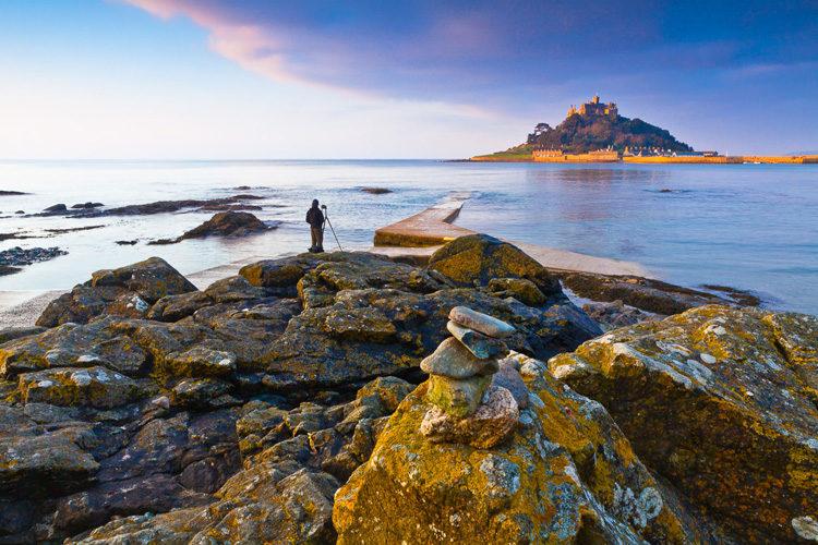 photographer and Scotland landscape with castle