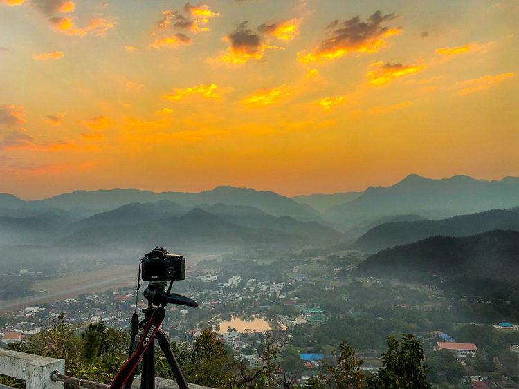 landscape photography checklist camera and tripod overlooking a scene