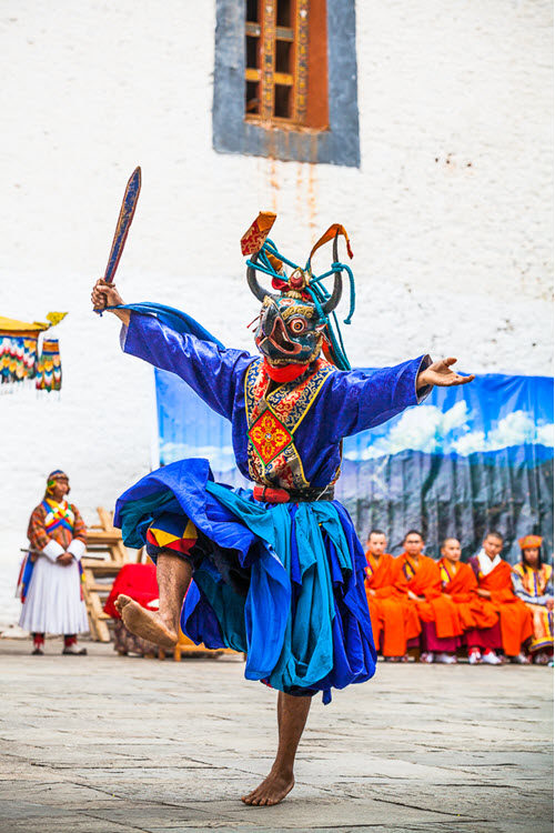 Man in traditional bhutanese costume dances
