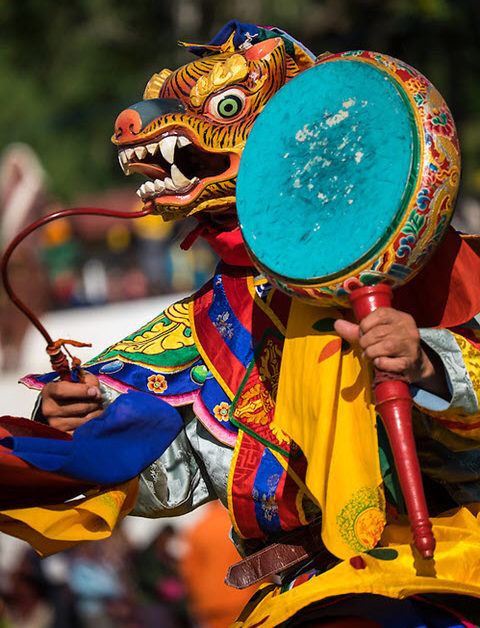Mask performer dancing during the Tshechu Festival inl Bhutan