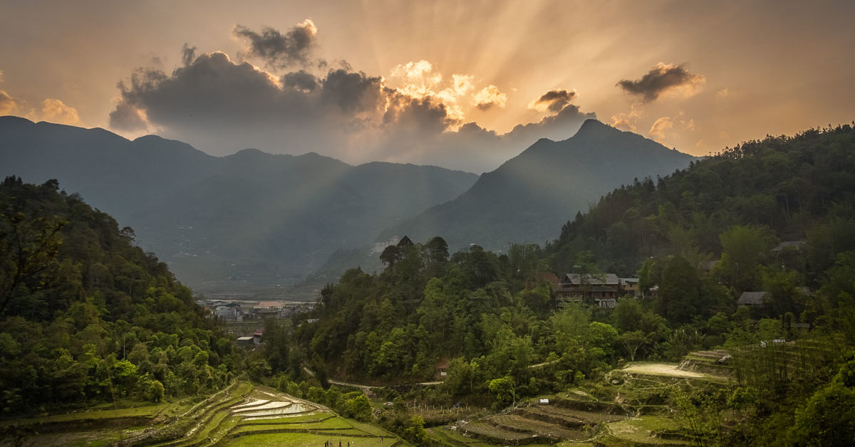 sunlight streaks across the vietnamese landscape on this photo tour of vietnam