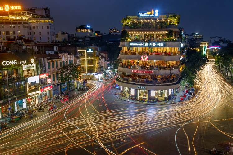 car light trails on a busy street in Vietnam.