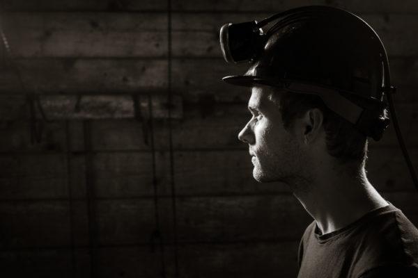 A dramatic portrait of a coal miner