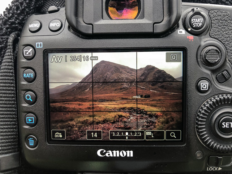a landscape photo is shown on a Canon camera screen