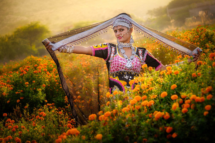 Traditionally dressed Indian woman in a field of marigolds photo after Luminar Flex
